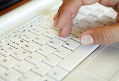Hand over keyboard Stock Images