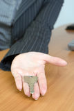 Hand over keys. Key is hand overed by a woman Stock Images