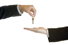 Hand-over of keys. One male hand give another male hand keys Stock Images