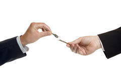 Hand-over of keys. One male hand give another male hand keys Stock Photos