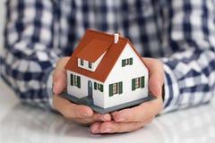 Free Hand Over Mini House Stock Photo - 31706720