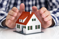 Hand over mini house Stock Photo
