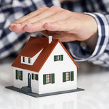 Hand over mini house Stock Images