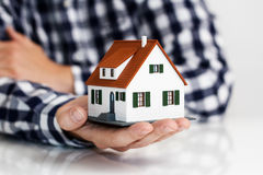 Hand over mini house royalty free stock photography