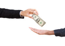 Hand over money to another hand . Royalty Free Stock Photos