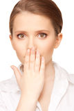 Hand over mouth Royalty Free Stock Photography