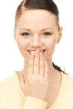 Hand over mouth Royalty Free Stock Image