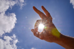 Hand over the Sky and Sun Royalty Free Stock Photography
