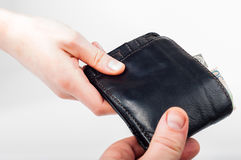 Hand over wallet with money from hand to hand Royalty Free Stock Photos
