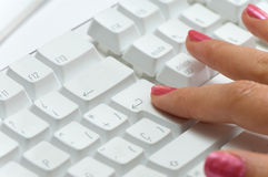 Hand over white keyboard Royalty Free Stock Photography