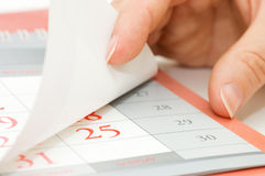 The hand overturns calendar sheet Royalty Free Stock Image