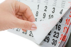The hand overturns calendar sheet Royalty Free Stock Photo