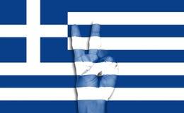Hand på den Grekland flaggabakgrunden Fotografering för Bildbyråer
