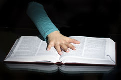 Hand on pages of open book Royalty Free Stock Photography