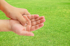 Hand pain on green grass background Stock Images