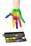 Hand in paint with brush Stock Photography