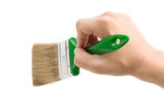 Hand and paint brush Stock Image