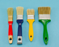 Hand paint brush color different size on blue Stock Image