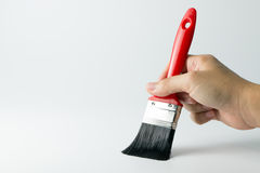 Hand with paint brush Stock Image