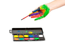 Hand in paint with brushes Royalty Free Stock Photography