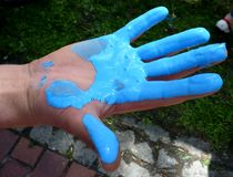Hand in the paint Stock Photography
