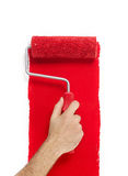 Hand with paint roller Royalty Free Stock Image