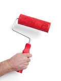 Hand with paint roller Stock Image