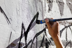 Hand paint wall with brush Royalty Free Stock Photo