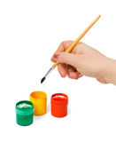Hand with paintbrush Stock Image