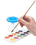 Hand with paintbrush Stock Images