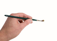 Hand with paintbrush Stock Photos