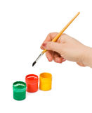 Hand with paintbrush Royalty Free Stock Photo