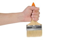 Hand and paintbrush Stock Photos