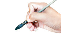 Hand with paintbrush isolated Stock Photos