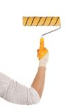 Hand with paintbrush roller. Royalty Free Stock Image