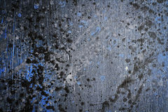Hand Painted Black Splatter Texture. Hand painted splattered black, blue and grey wood grain texture background with acrylic paint splatter royalty free stock photo