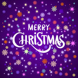 Hand painted brush lettering 'We wish you a merry Christmas'. White snowflakes on violet and pink blurred background. Royalty Free Stock Photo