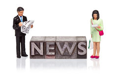 NEWS word in letterpress with miniature people reading Stock Photo