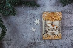 Hand painted Christmas gingerbread horse on a carousel on a beautiful grey background. Card concept. Top view. Flat lay. Copy royalty free stock photo