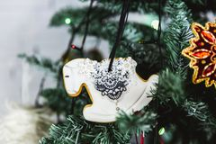Hand painted Christmas gingerbread horse on Christmas tree. Close-up stock photography