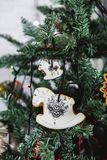 Hand painted Christmas gingerbread horse on Christmas tree. Close-up royalty free stock image