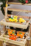 Hand painted Christmas gingerbread orange train on wooden stand stock photo