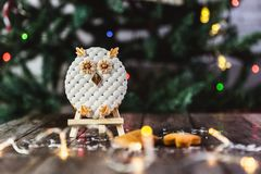 Hand painted Christmas gingerbread owl on a wooden stand with abstract bokeh background. Close-up royalty free stock images