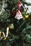 Hand painted Christmas gingerbread white tree on Christmas tree. Close-up royalty free stock photos