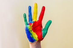 Hand painted in colorful paints ready for hand prints. Girl hand painted in colorful paints ready for hand prints royalty free stock photography
