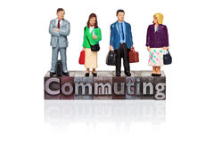 Commuting word in letterpress with miniature. Hand painted commuters figurines and the word Commuting in old metal letterpress isolated on a white background Royalty Free Stock Photo