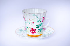 Hand-painted cup and saucer royalty free stock photo