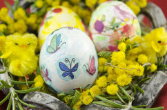 Hand painted decoupage Easter egg in a basket Royalty Free Stock Photos