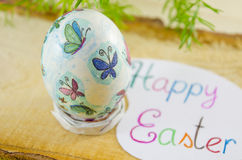 Hand painted decoupage Easter egg on a wooden surface Royalty Free Stock Images