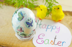 Hand painted decoupage Easter egg on a wooden surface Stock Photography